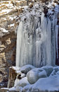 Bevroren waterval in de winter Stock Foto