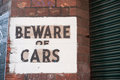 Beware of cars sign indicating to Stock Photo
