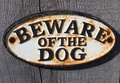 Beware of the dog sign a on a wooden fence Stock Photo