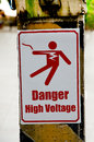 Beware of electric shock on cement pole Stock Photo