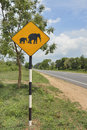 Beware elephants roadsign sign on open country road sri lanka Royalty Free Stock Photo