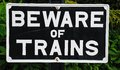 Beware of trains sign. Royalty Free Stock Photo