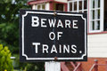 Beware of trains a sign on the south tynedale railway in northern england Stock Photos