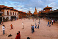 Bhaktapur nepal kathmandu oct tourists visiting the famous durbar square of at sunset part of unesco heritage on october in Royalty Free Stock Image