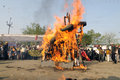 Bhopal december the burning effigy in front of the statue of mother during the rally to mark the th year of the gas Royalty Free Stock Images