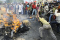 Bhopal december violent victims hit the burning effigy during the rally to mark the th year of the gas tragedy in Stock Photos