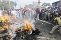 Bhopal december violent victims hit the burning effigy during the rally to mark the th year of the gas tragedy in Royalty Free Stock Photo