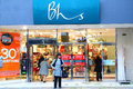 Bhs british home stores store front retail department facade with shoppers and sales signs major uk high street brand with approx Royalty Free Stock Images