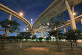 Bhumibol industrial circle bridge above park a at dusk in bangkok thailand Stock Photo