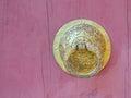Bhutan style metal door knob on wooden background Royalty Free Stock Image
