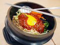 Bibimbap in a heated stone bow Royalty Free Stock Photos