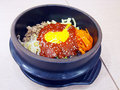 Bibimbap in a heated stone bow Royalty Free Stock Image