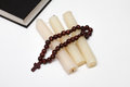 Bible book and rosary with three candle