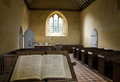 Bible and church a the interior of an ancient norman in wiggonholt sussex england Stock Images