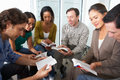 Bible group reading together sitting in circle Stock Photography