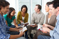 Bible group reading together sitting in circle Royalty Free Stock Image