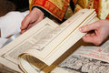 Bible hands of a priest who browse pages of the Stock Photos