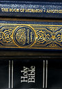Bible and Koran (Qur'an) and Book of Mormon Royalty Free Stock Photos