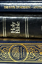 Bible and Koran (Qur'an) and Book of Mormon Stock Photo