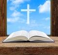 Bible open christian cross light sky view Royalty Free Stock Photo