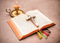 A bible open on a table with burning candle Royalty Free Stock Photo