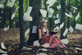 Bible pages flying a woman reads her with the everywhere Royalty Free Stock Images