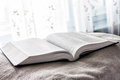 The bible photo of open near a light window Royalty Free Stock Image