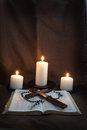 Bible, Rosary, Crucifix and Three Candles Royalty Free Stock Photo