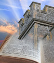 Bible is a tower and stronghold photo of fortress rising from the pages of an open depicting god s word to those with Royalty Free Stock Image
