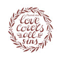 Biblical background with hand lettering Love covers all sins