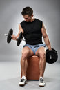 Biceps curl in seated position Royalty Free Stock Photo