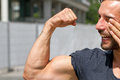 Biceps of a man athletic laughing and showing his Stock Photography