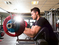 Biceps preacher bench arm curl workout man at gym Royalty Free Stock Photo