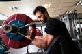 Biceps preacher bench arm curl workout man at gym Royalty Free Stock Photo
