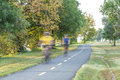 Biciclists in park unrecognizable bicyclists ride on asphalt exercise pathway winding through gravelly point arlington virginia on Royalty Free Stock Photography