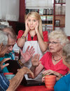 Bickering Seniors and Young Waitress Royalty Free Stock Photos