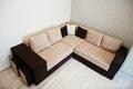Bicolor cofee corner sofa bed at light room Royalty Free Stock Photo
