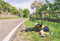 Bicycle accident on the road - Biker in troubles Royalty Free Stock Photo