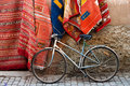 Bicycle and carpets on the street of Morocco Royalty Free Stock Image