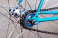 Bicycle chain with blue pinion Royalty Free Stock Images