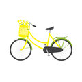 Bicycle and chamomiles with yellow colored female frame yellow pannier on handlebar with big bouquet of in it big dark grey saddle Royalty Free Stock Photography