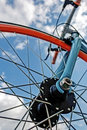 Bicycle detail blue bike frame and wheel orange on a background of sky Stock Photos