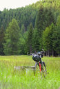 Bicycle in the field among high mountains Royalty Free Stock Photos