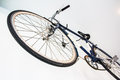 Bicycle fixed gear on white wall Royalty Free Stock Photography
