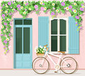 Bicycle with flowers near provence style house. Vintage building facade. Vector set: door, window, bicycle, flowers. Royalty Free Stock Photo