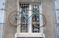 Bicycle hanging on the window funny photo taken in warsaw poland Royalty Free Stock Image
