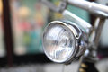 Bicycle headlamp crome vintage with blurred background Stock Image
