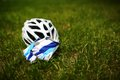 Bicycle helmet on grass Royalty Free Stock Photo