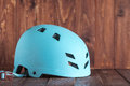 Bicycle helmet on a red background old wood. Royalty Free Stock Photo