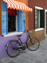 Bicycle on the island of burano venice italy colourful houses and waterways in venetian lagoon Stock Photography